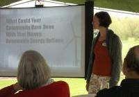 """Former Board co-chair Cham Nusz presents at WNPJ's """"Bring our war $$ home!"""" houseparty"""