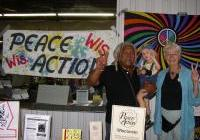 George, Nadja, and Julie at the Peace Action table