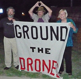Brian Terrell (left) and other drone protesters